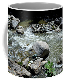 Coffee Mug featuring the photograph Stream Water Foams And Rushes Past Boulders by Imran Ahmed