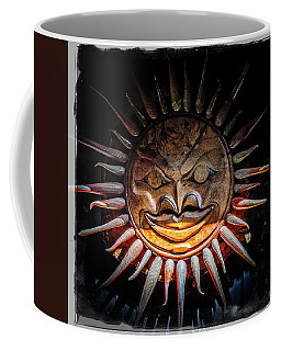 Sun Mask Coffee Mug