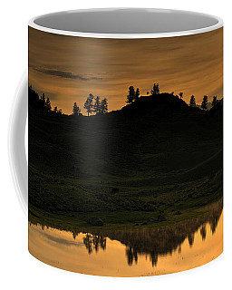 Coffee Mug featuring the photograph Sunrise Behind A Yellowstone Ridge by Bill Gabbert