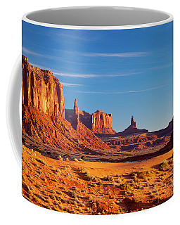 Coffee Mug featuring the photograph Sunrise Over Monument Valley by Brian Jannsen