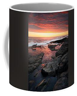 Sunset Over Rocky Coastline Coffee Mug