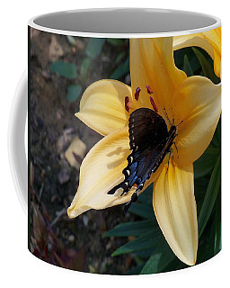 Coffee Mug featuring the photograph Swallowtail On Asiatic Lily by Kathryn Meyer