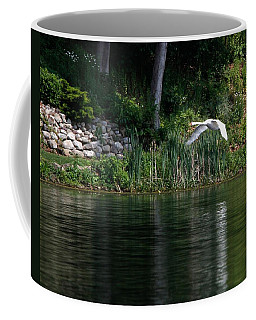 Coffee Mug featuring the photograph Swan In Flight by Eleanor Abramson