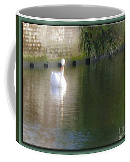 Coffee Mug featuring the photograph Swan In The Canal by Victoria Harrington