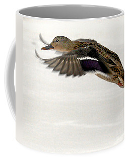 Coffee Mug featuring the photograph Taking Off by John Telfer