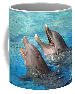 Coffee Mug featuring the photograph Talking Dolphins by Kristine Merc