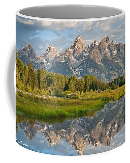 Teton Range Reflected In The Snake River Coffee Mug by Jeff Goulden