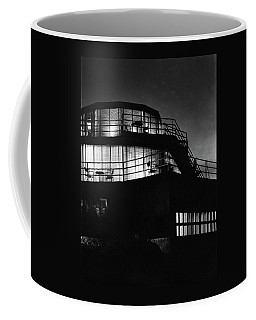 The Exterior Of A Spiral House Design At Night Coffee Mug