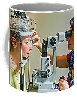 The Eye Doctor Coffee Mug by Keith Armstrong
