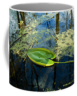 Coffee Mug featuring the photograph The Floating Leaf Of A Water Lily by Verana Stark