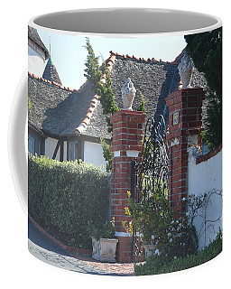 Coffee Mug featuring the photograph The Gated Castle by Laurie Lundquist