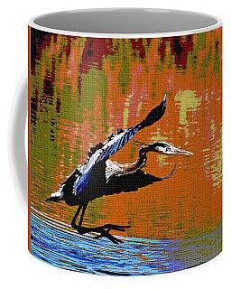 The Great Blue Heron Jumps To Flight Coffee Mug by Tom Janca