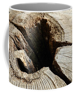The Hole Coffee Mug by Clare Bevan