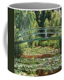 The Japanese Footbridge And The Water Lily Pool Giverny Coffee Mug by Claude Monet