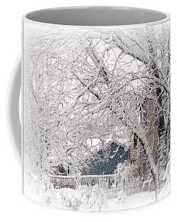 Coffee Mug featuring the photograph The Last Snow Storm by Kay Novy