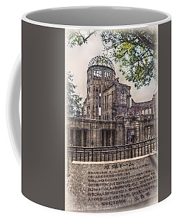 Coffee Mug featuring the photograph The Memorial by Hanny Heim