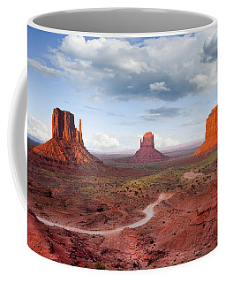 The Mittens And Merrick Butte At Sunset Coffee Mug by Jeff Goulden