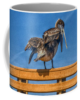 Coffee Mug featuring the photograph The Pelican by Hanny Heim
