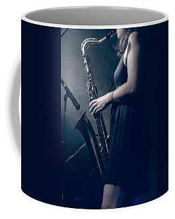 Coffee Mug featuring the photograph The Saxophonist Sounds In The Night by Bob Orsillo