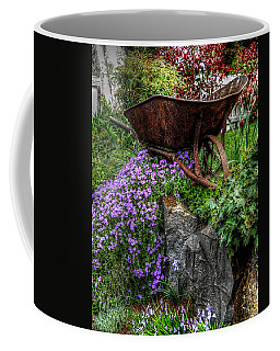 Coffee Mug featuring the photograph The Whimsical Wheelbarrow by Thom Zehrfeld