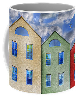 Three Buildings And A Bird Coffee Mug by Paul Wear