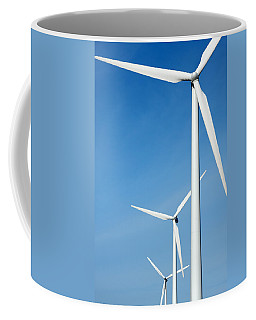 Three Mighty Windmills In A Row Against A Blue Sky. Coffee Mug