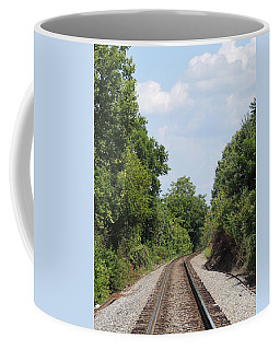 Coffee Mug featuring the photograph Traxs To Anywhere by Aaron Martens
