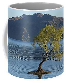 Coffee Mug featuring the photograph Tree In Lake Wanaka by Stuart Litoff