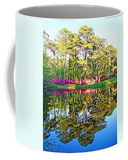 Tree Reflections And Pink Flowers By The Blue Water By Jan Marvin Studios Coffee Mug