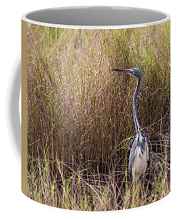 Coffee Mug featuring the photograph Tricolored Heron Peeping Over The Rushes by John M Bailey