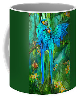 Tropic Spirits - Gold And Blue Macaws Coffee Mug by Carol Cavalaris
