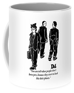 Two Businessmen Talk About Another Whose Coffee Mug