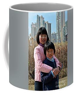 Two Chinese Teen Sisters Hug  And Embrace Shanghai China Coffee Mug