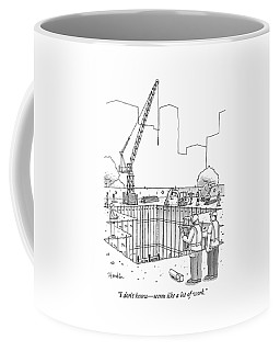 Two Construction Workers Look Out Over A Massive Coffee Mug