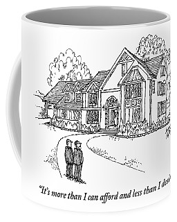 Two Men Stand Looking At A Large House Coffee Mug