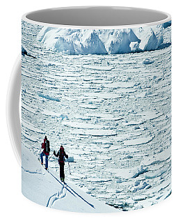 Two Skiers Looking Out At Ocean Covered Coffee Mug
