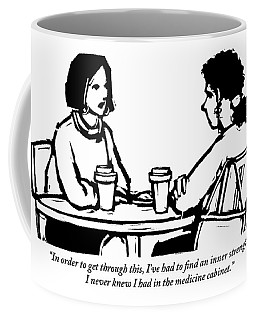 Two Women Are Seen Sitting And Speaking With Each Coffee Mug