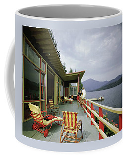 Two Women On The Deck Of A House On A Lake Coffee Mug