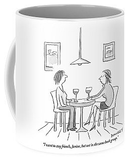 Two Women Sit Across From Each Other At A Small Coffee Mug