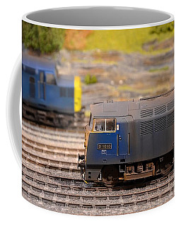 Coffee Mug featuring the photograph Two Yellow Blue British Rail Model Railway Train Engines by Imran Ahmed