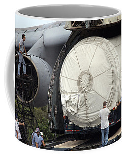 Coffee Mug featuring the photograph Unloading A Titan Ivb Rocket by Science Source