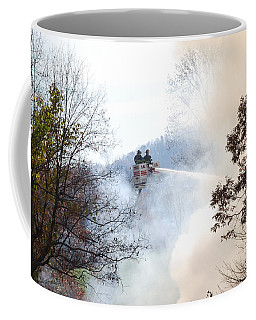Coffee Mug featuring the photograph Up In Smoke by Eric Liller