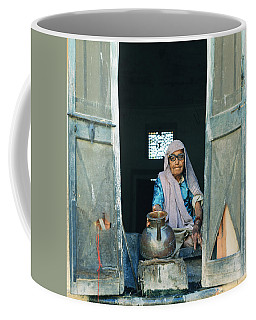 Varanasi Water Seller Coffee Mug by Shaun Higson