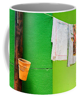 Coffee Mug featuring the photograph Vase Towels And Green Wall by Silvia Ganora