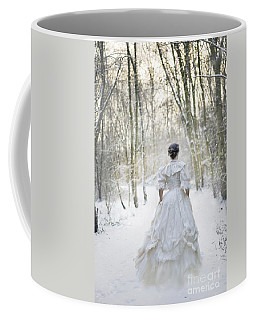 Victorian Woman Running Through A Winter Woodland With Fallen Sn Coffee Mug by Lee Avison