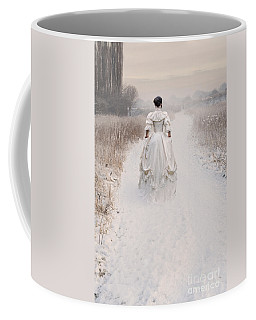 Victorian Woman Walking Through A Winter Meadow Coffee Mug by Lee Avison
