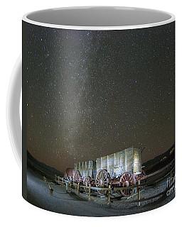 Wagon Train Under Night Sky Coffee Mug
