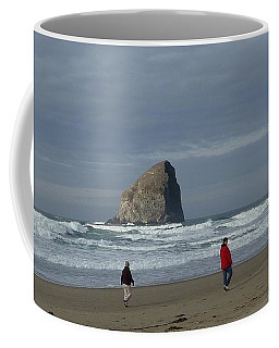 Coffee Mug featuring the photograph Walking On The Beach by Susan Garren