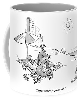 Warmly Dressed Couple On A Beach Under An Coffee Mug