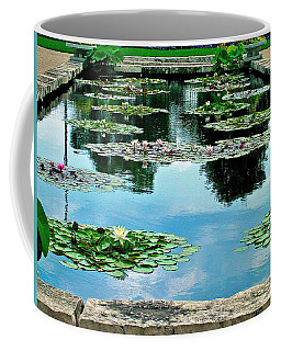 Coffee Mug featuring the photograph Water Lily Garden by Zafer Gurel